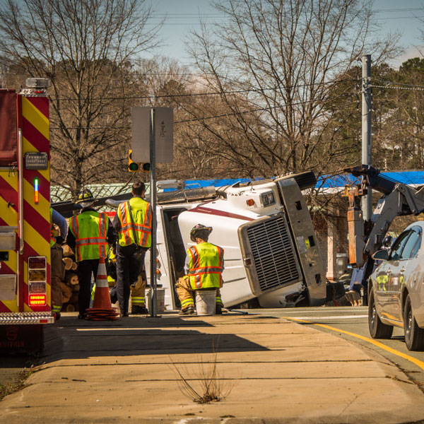 semi truck turned over with emergency vehicles