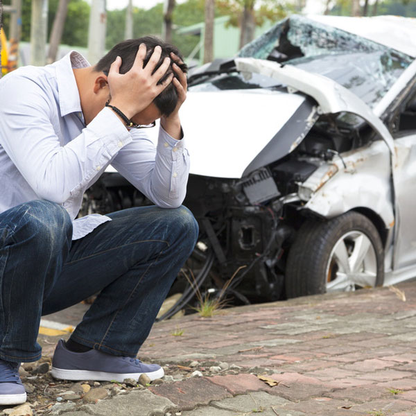 man in despair after car accident