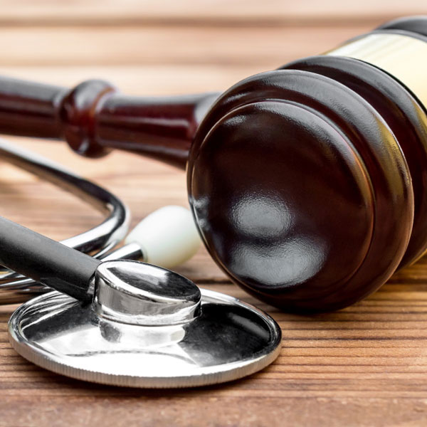 legal gavel and stethoscope