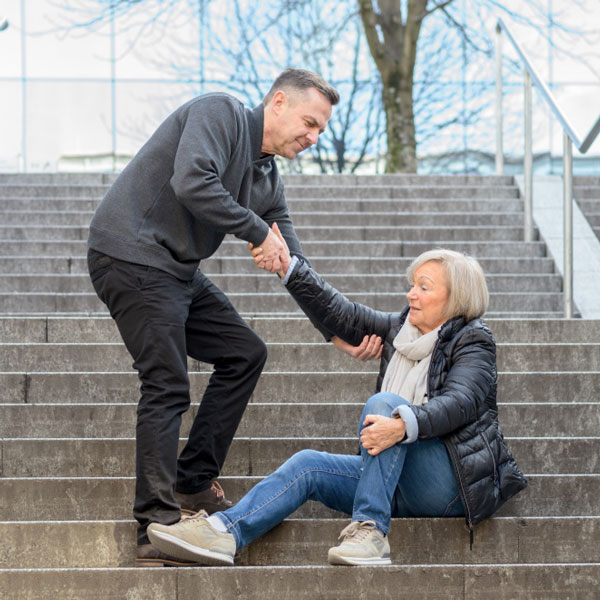 older woman falling on stairs